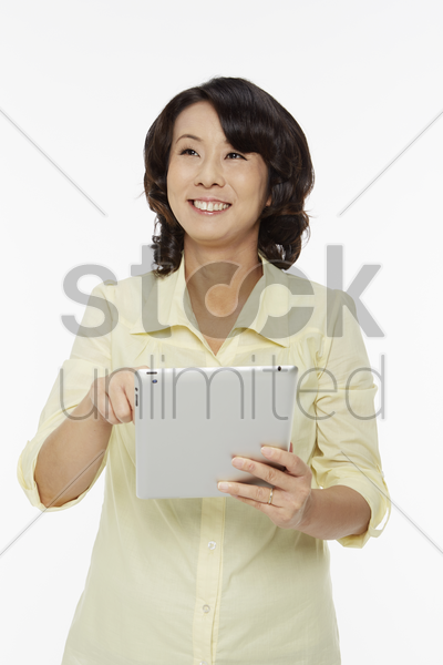 woman using a digital tablet stock photo