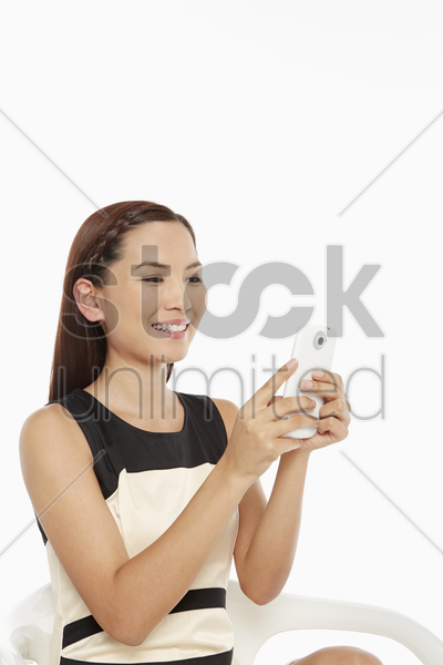 woman using a mobile phone, text messaging stock photo
