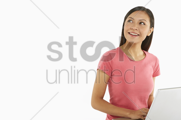 woman using laptop, contemplating stock photo