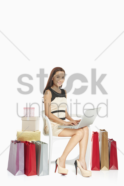 woman using laptop while sitting stock photo