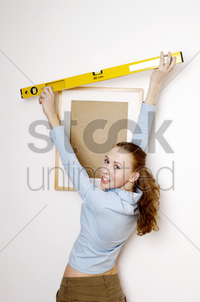 woman using spirit level stock photo