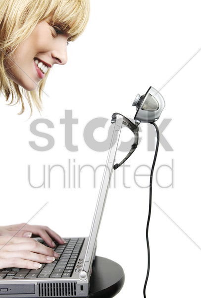 woman video calling over the internet stock photo