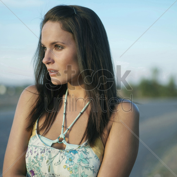 woman waiting by the roadside stock photo