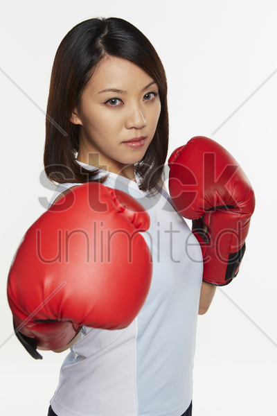 woman wearing boxing gloves stock photo