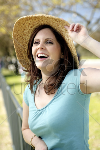 woman wearing straw hat stock photo