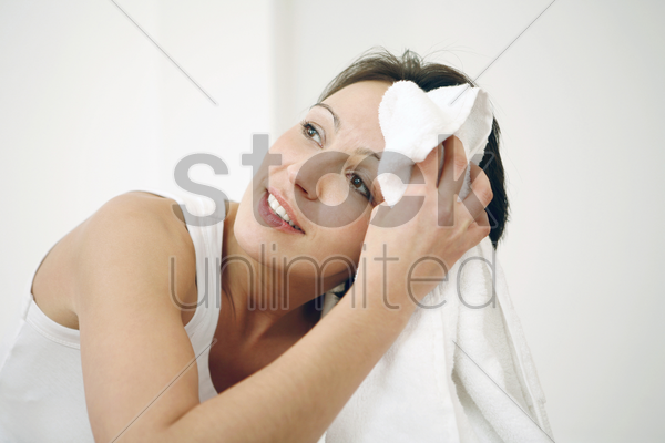 woman wiping her sweat with towel stock photo