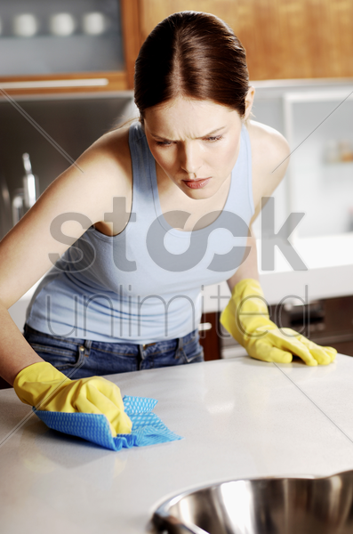woman wiping the table stock photo