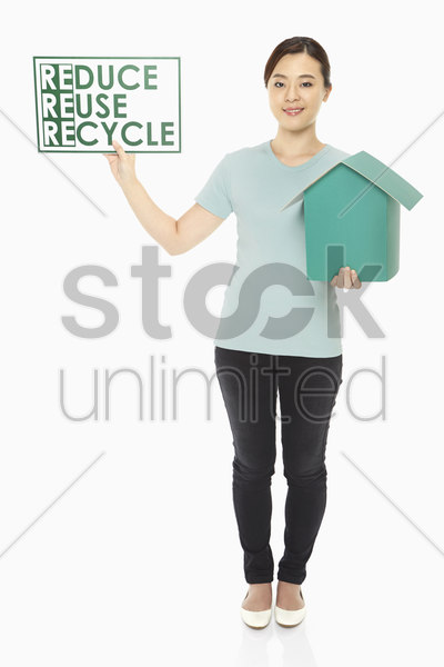 woman with a cardboard house and a placard stock photo