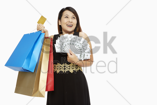 woman with a credit card and cash stock photo