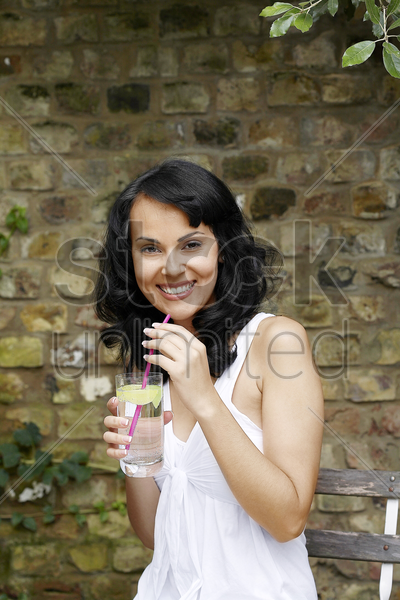 woman with a glass of lime juice stock photo