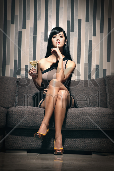 woman with a glass of martini stock photo