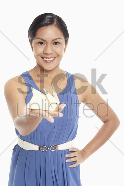 woman with a miniature paper rabbit on her palm stock photo