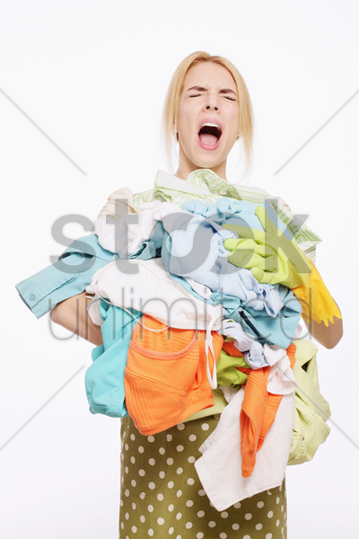 woman with a pile of clothing stock photo