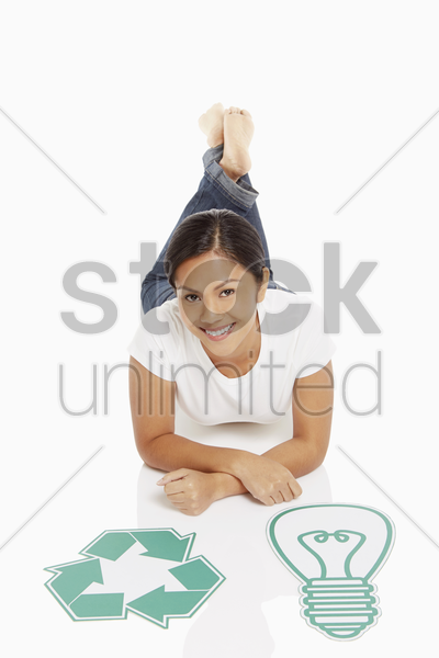 woman with a recycle logo and a cardboard light bulb stock photo