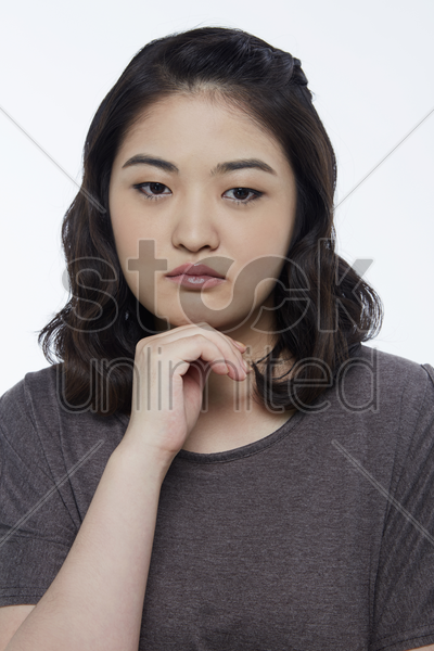 woman with a sad facial expression, contemplating stock photo