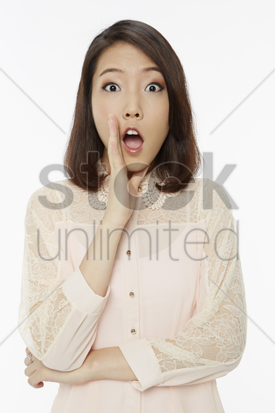 woman with a shocked facial expression stock photo