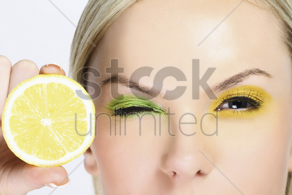 woman with a slice of lemon stock photo