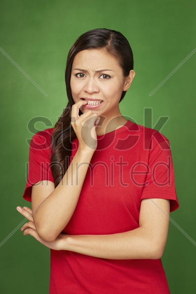 woman with an anxious expression stock photo
