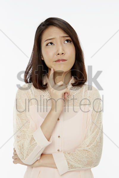 woman with an unsure look on her face stock photo
