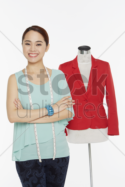woman with arms crossed, smiling stock photo