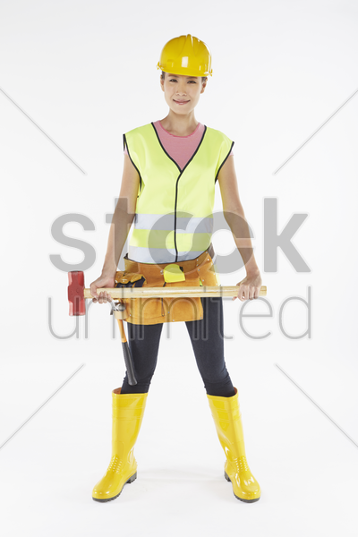woman with construction equipment stock photo