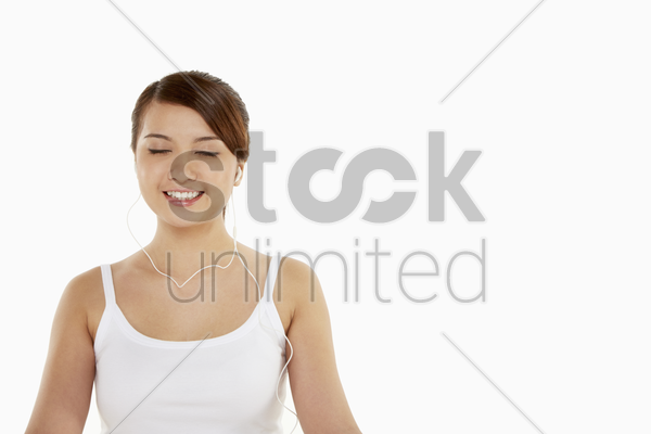 woman with earphones on, smiling stock photo