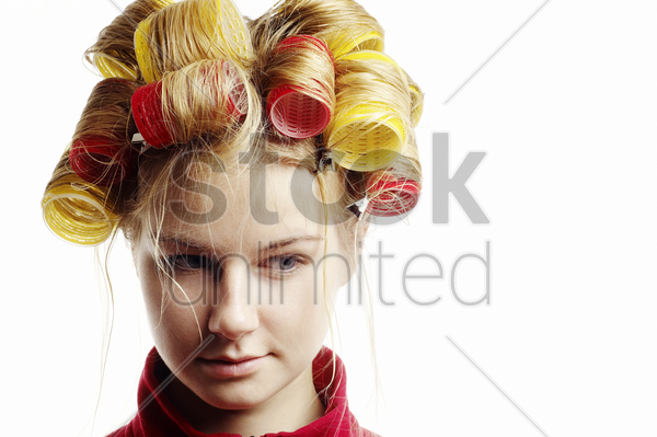 woman with hair in curlers stock photo