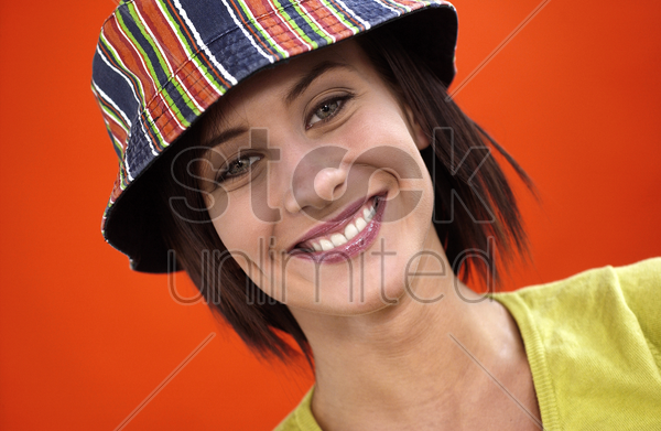 woman with hat smiling stock photo