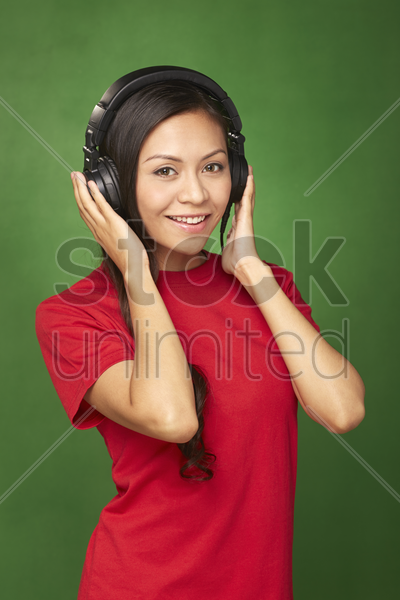 woman with headphone smiling at the camera stock photo