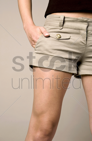 woman with her hand in the pocket stock photo