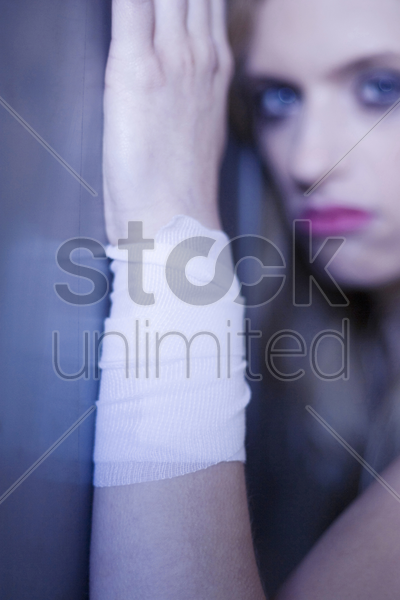 woman with injured wrist stock photo
