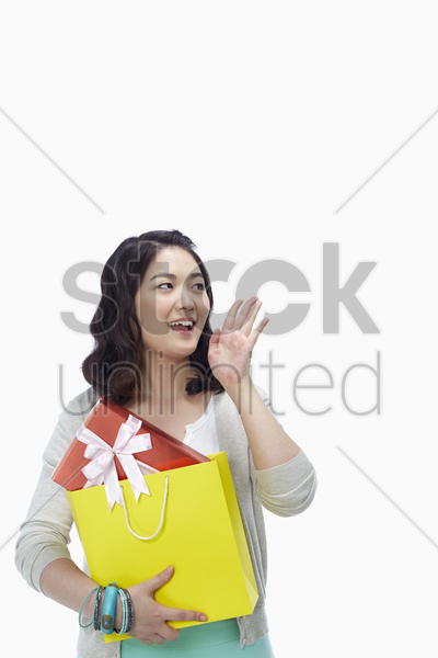 woman with paper bag shouting out stock photo