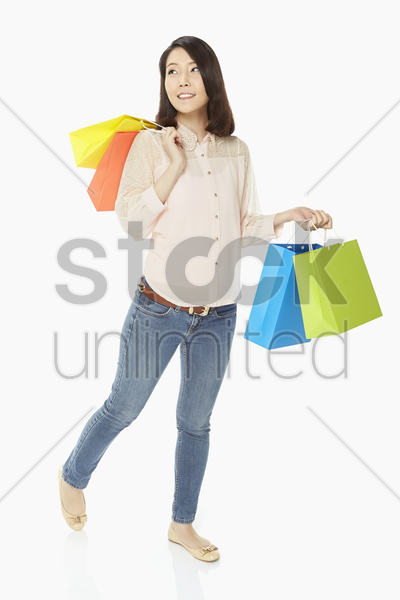 woman with paper bags, smiling stock photo