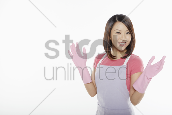 woman with rubber gloves smiling at the camera stock photo