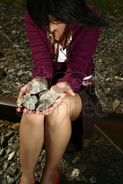woman with stones on her palm stock photo