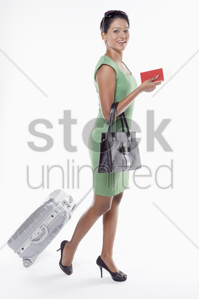 woman with suitcase and passport stock photo