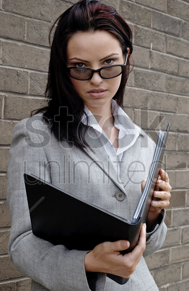 woman with sunglass reading a document stock photo