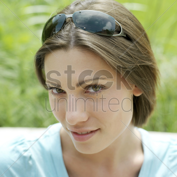 woman with sunglasses on her head stock photo