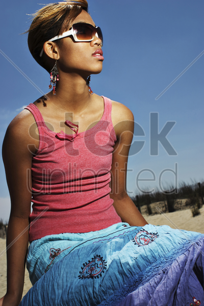 woman with sunglasses posing for the camera stock photo