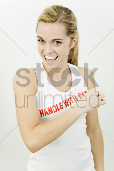woman with the word 'handle with care' on her sleeveless top stock photo