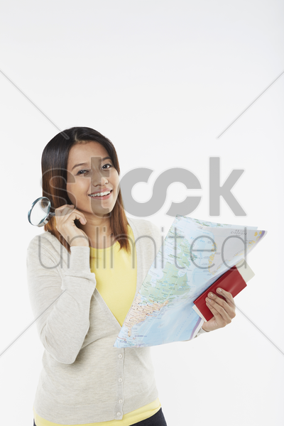 woman with traveling items stock photo