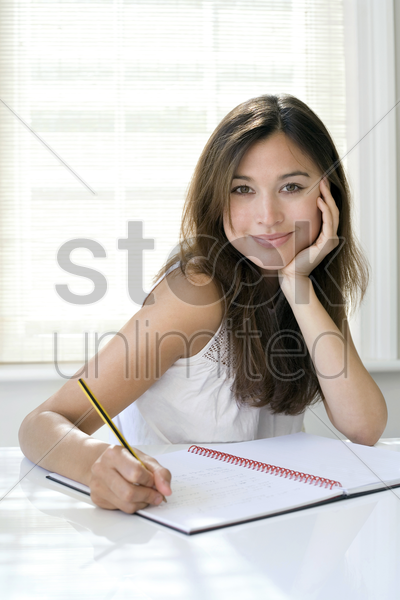 woman working at her desk in a home office stock photo