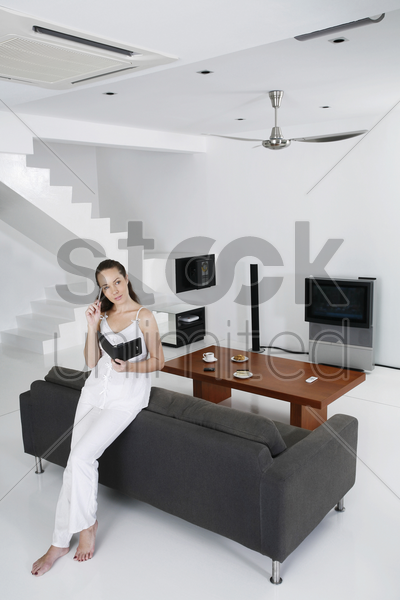 woman writing on organizer stock photo