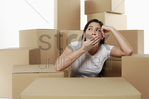 woman yawning while thinking stock photo