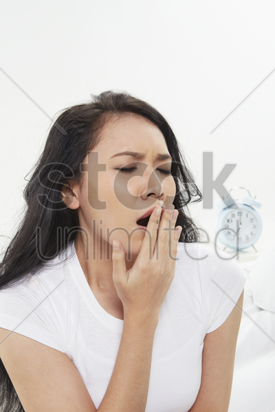 woman yawning stock photo