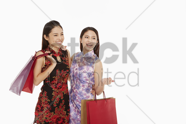 women carrying shopping bags stock photo