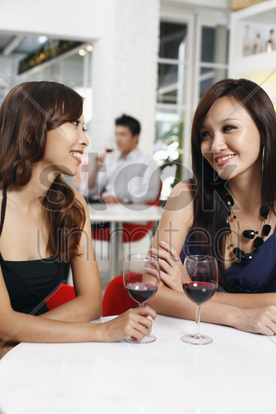 women enjoying wine stock photo