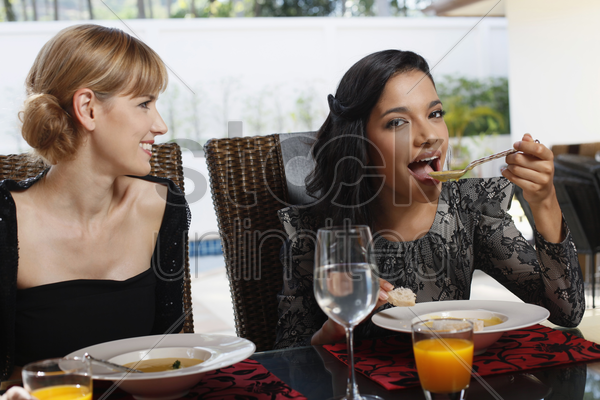 women having lunch together stock photo