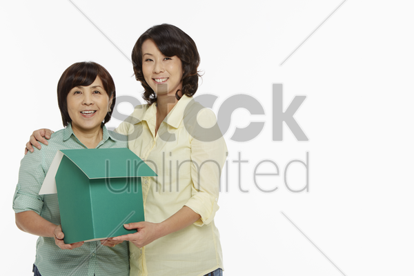 women holding a cardboard house stock photo