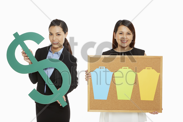 women holding up a dollar sign and a pin board stock photo